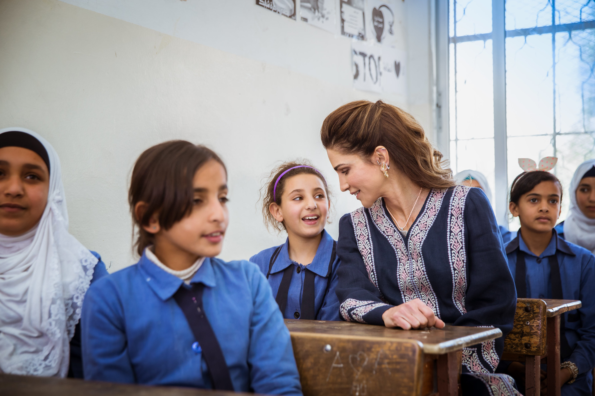 queen rania in a classroom